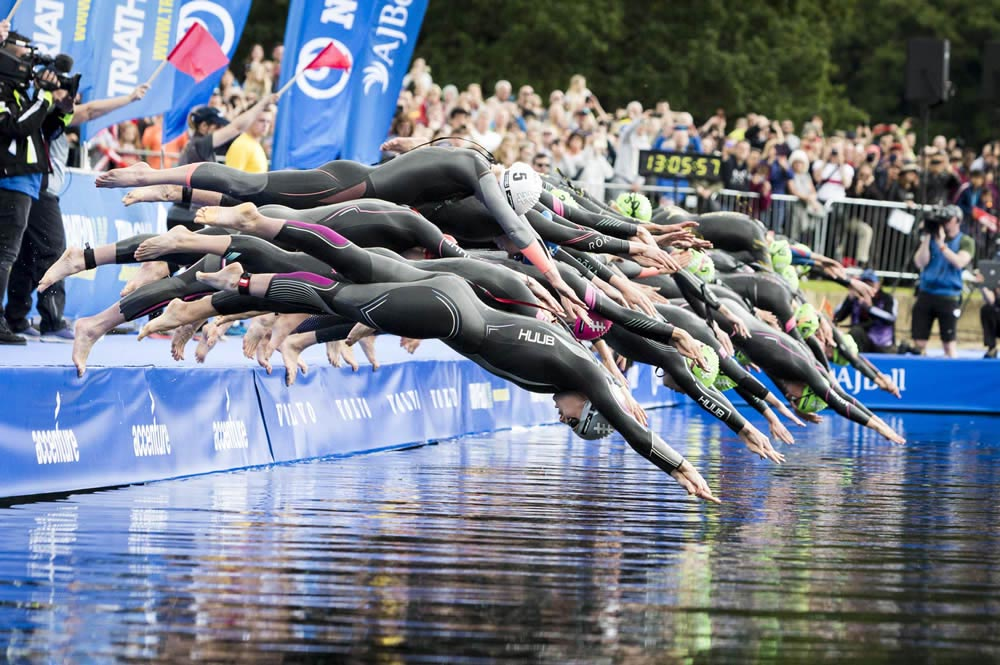 Swimmers at the start line of Leeds World Triathlon in Roundhay Park