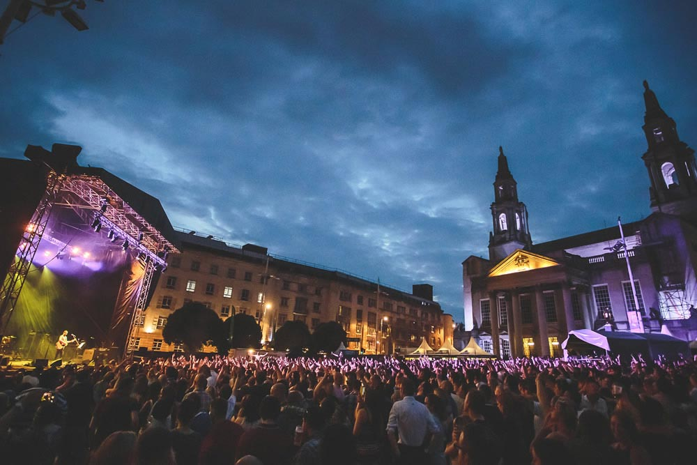 Crowd shot featuring Leeds Civic Hall and stage with Ocean Colour Scene performing at Millennium Square Summer Series (photo by Danny Payne)